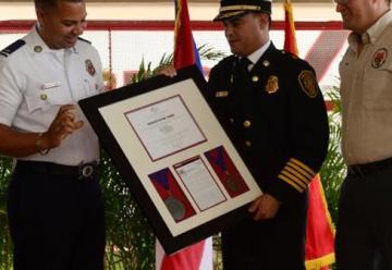 Cuerpo de Bomberos firma acuerdo con la NFPA