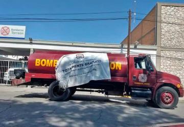 Empresas apoyan con pipas a Bomberos en Mexico